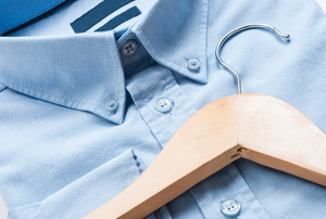 men's crisp button-up shirt and wooden hanger