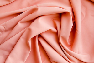 bunched-up pink viscose fabric