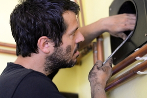 A man works on a chimney.
