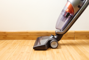 a vacuum cleaner on a wooden floor