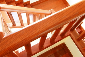 shiny clean wooden banister railing on wooden stairway from above