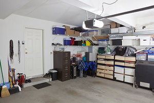 A cluttered garage being used for storage.