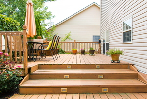 wood deck with lighted stairs