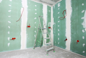Green board used in the construction of a room.