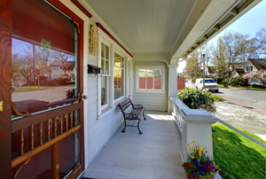 A front porch with a storm door.