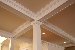 A beige ceiling with crown moldings.