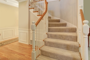 A carpeted set of stairs in a house.