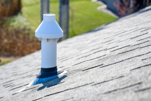 pvc chimney vent on a shingled roof