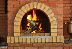 a brick fireplace with burning wood