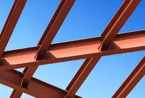 Metal beams against a blue sky.