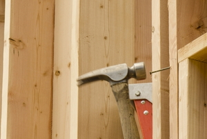 hammering a nail into a stud