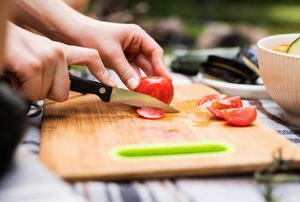 A knife cutting tomatoes.