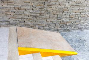 A short, concrete wheelchair access ramp.