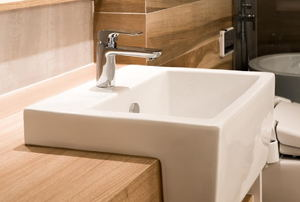 A square white porcelain bathroom sink.