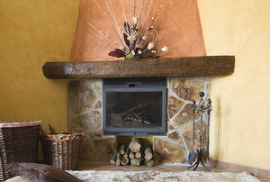 corner fireplace with river rock surround