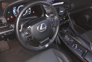 the steering wheel and dash of a car