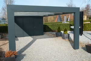 A modern carport with a gravel base.