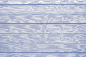 White, fiber cement wood texture siding.