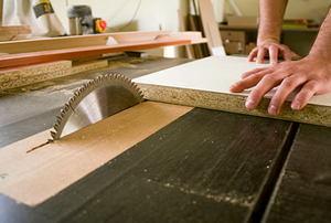 carpenter cutting a wood panel