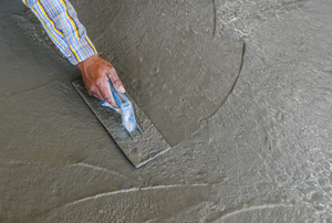 spreading self leveling compound on a floor