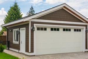 A garage door with windows.