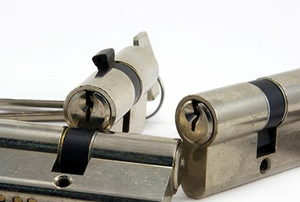Three lock cylinders isolated on a white background.