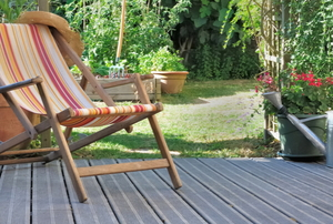 Chair on decking with landscaped yard in the background
