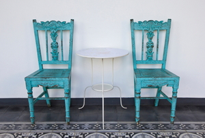 A set of blue shabby chic chairs.