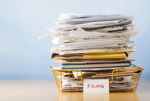 A stack of paperwork that needs to be filed.