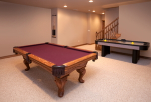A rec room with a pool and air hockey table.
