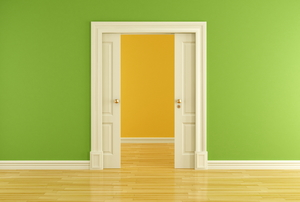 Double pocket door leading past a green wall into another room