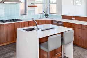 a small, clean kitchen with an island sink