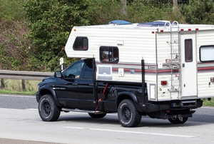 A truck with a camper.
