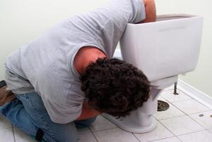 man installing a toilet