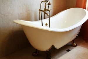 A white, cast iron bathtub.