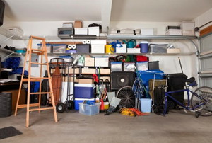 Wall of garage items on floor and shelving