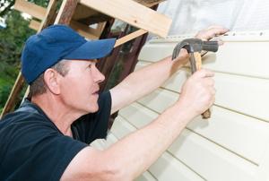 Man installing siding