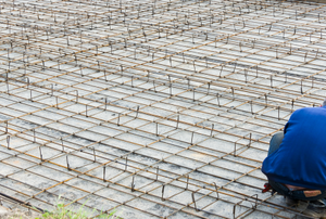 man working on rebar for a foundation