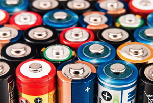 A large grouping of AA batteries stood on end.