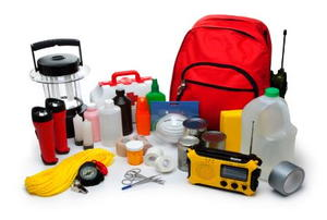 A variety of emergency supplies, including flashlights, water, first aid and a radio.