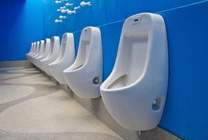 row of urinals in a bathroom