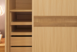 sliding wood closet doors revealing shelves in a room with a hanging lamp