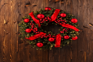 A Christmas wreath with red accents.
