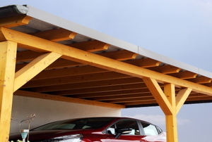 a carport covering a red car