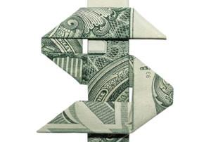 dollar bill folded into a dollar sign