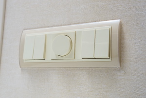 a dimmer switch on a wall