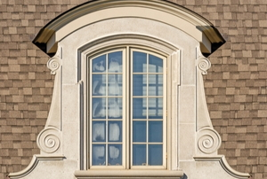arched dormer window in a tan roof