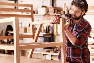 man building a wooden chair