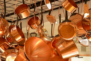 ceiling mounted pot and pan rack with brass cookware