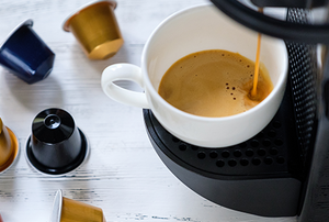 A Keurig coffee machine brewing coffee into a mug